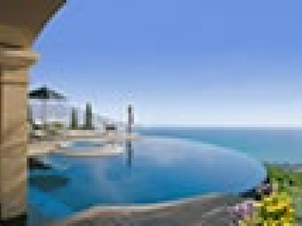 GUIDE TO BUYING PROPERTY IN CYPRUS By: Danos & Associates